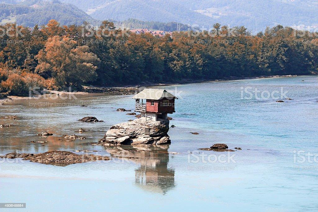house on rock Drina river Serbia landscape stock photo