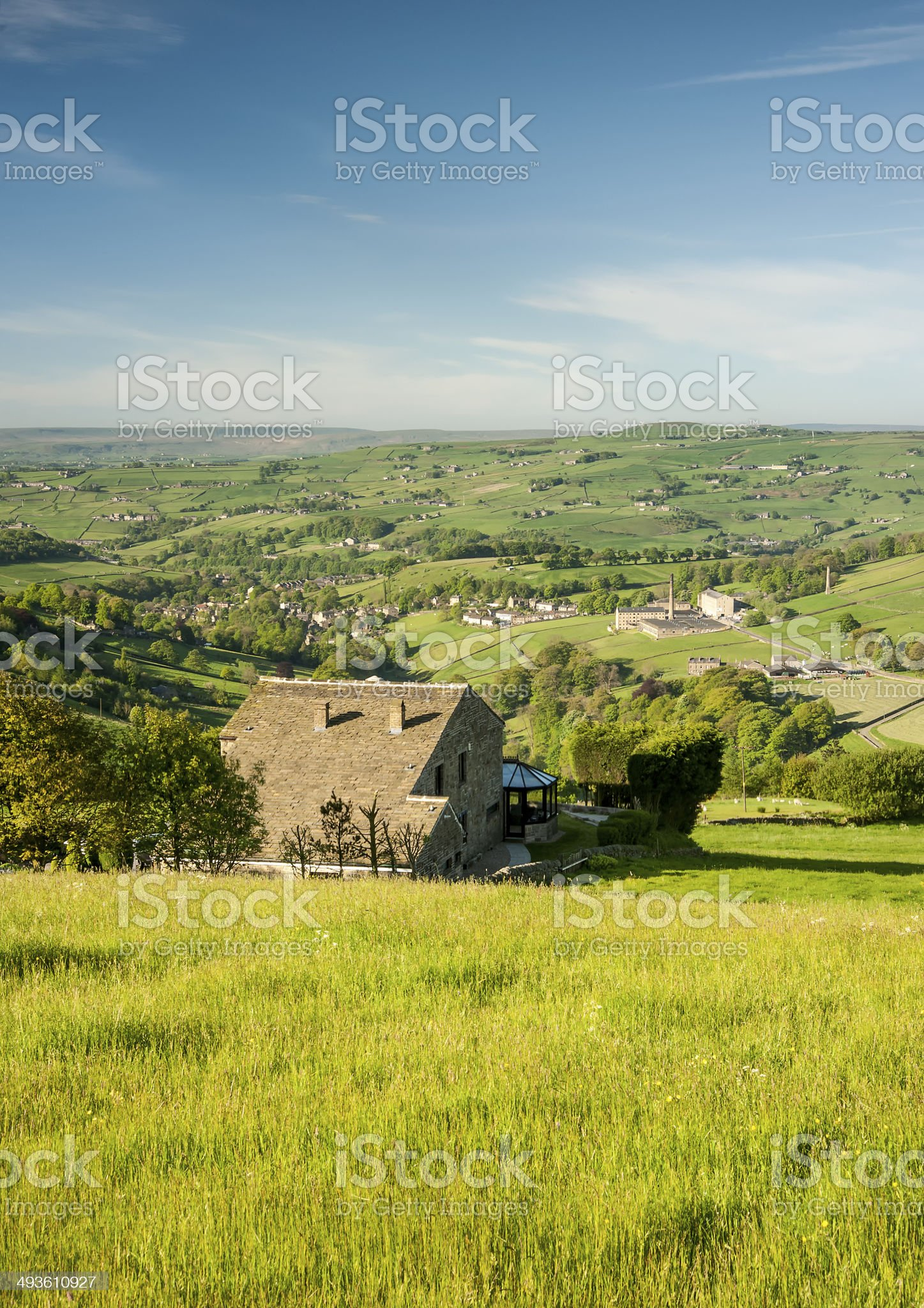 house overlooking green valley royalty-free stock photo