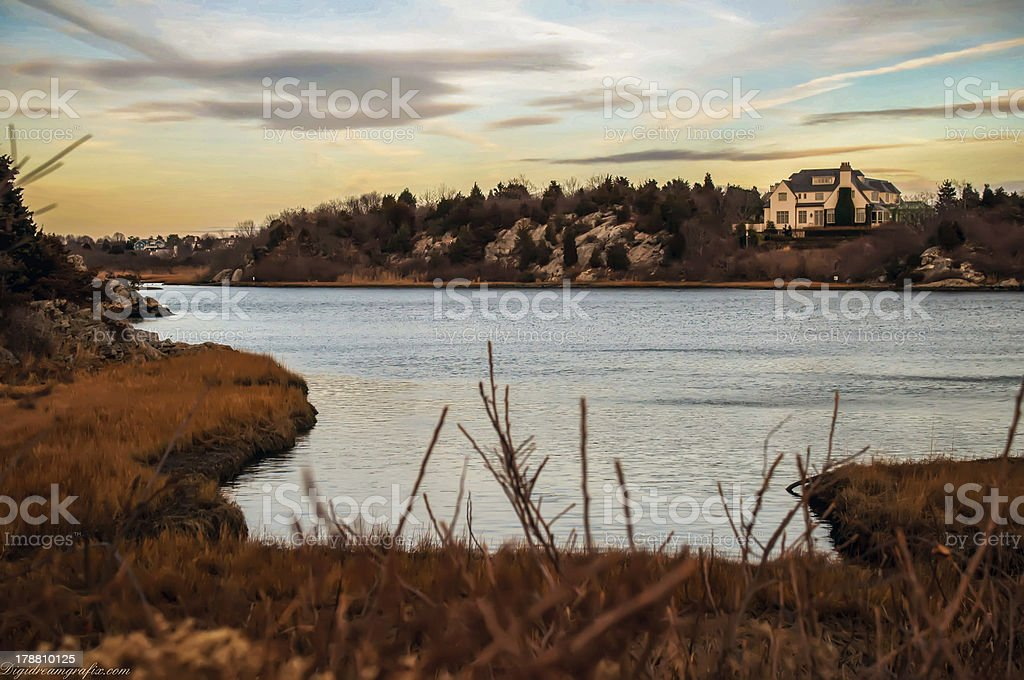 House overlooking  ocean at sunset on the coastline stock photo