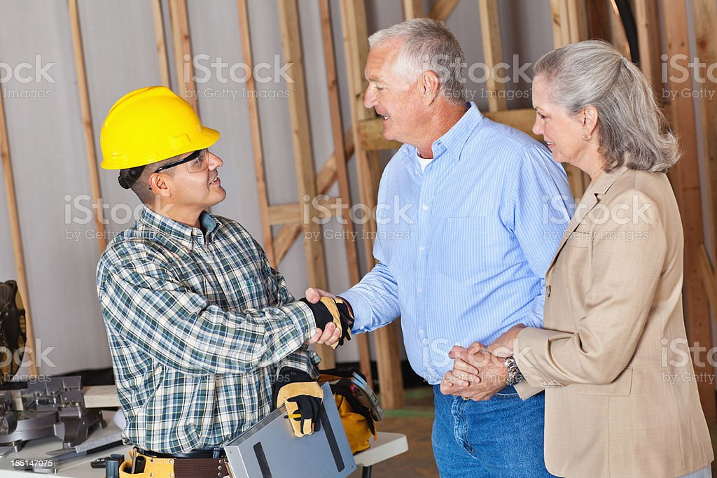 House owners greeting building contractor royalty-free stock photo