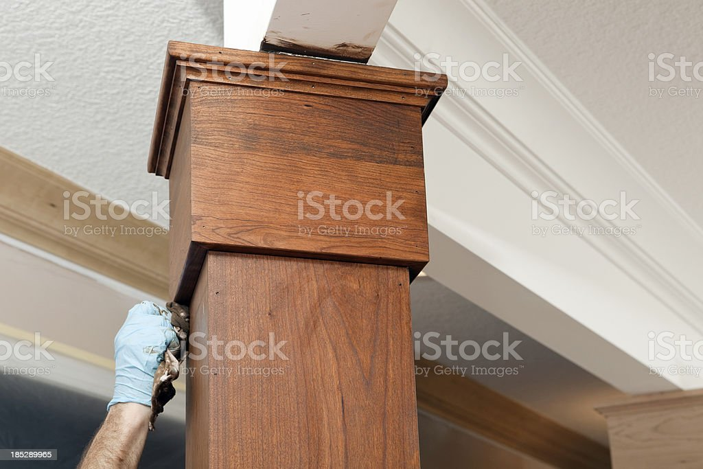 House Painter Applying Stain to a Cherry Column royalty-free stock photo