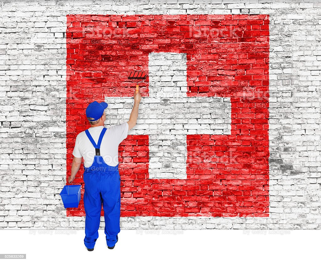House painter covers wall with flag of Switzerland stock photo