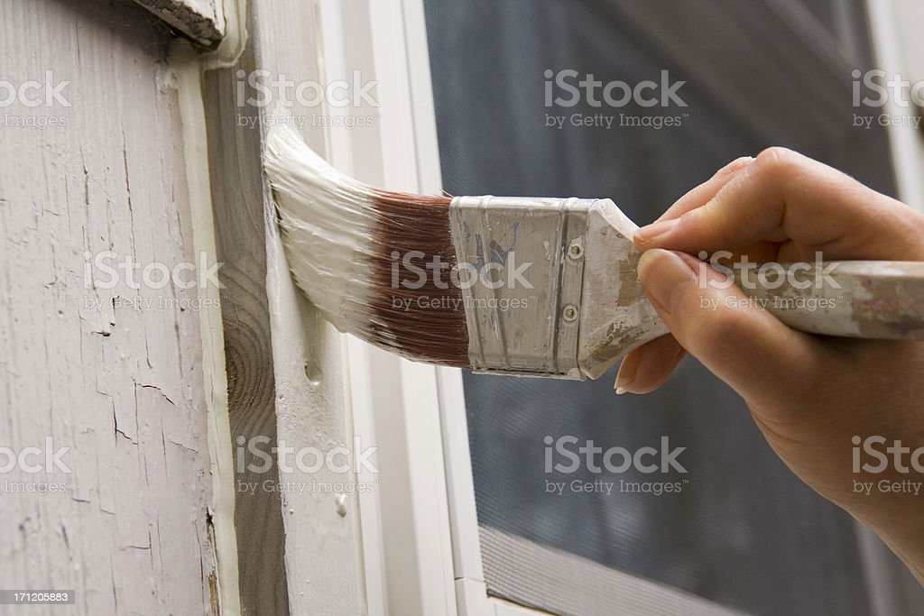 House Painter Painting, Repairing a Residential Structure for Home Improvement stock photo