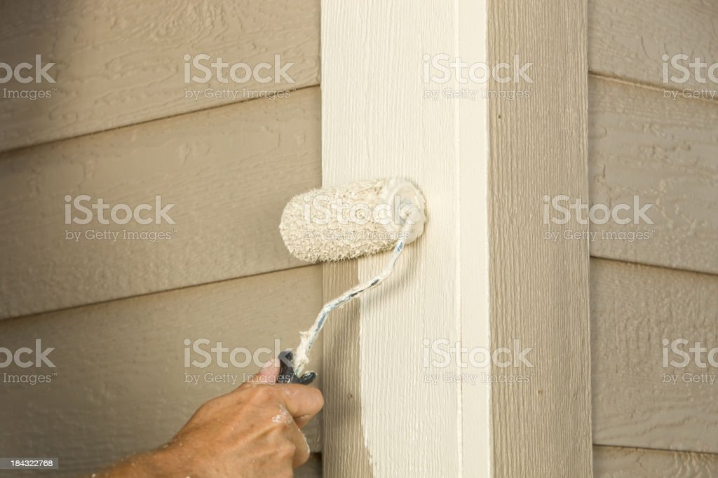 House Painter Rolling Siding Trim Board stock photo