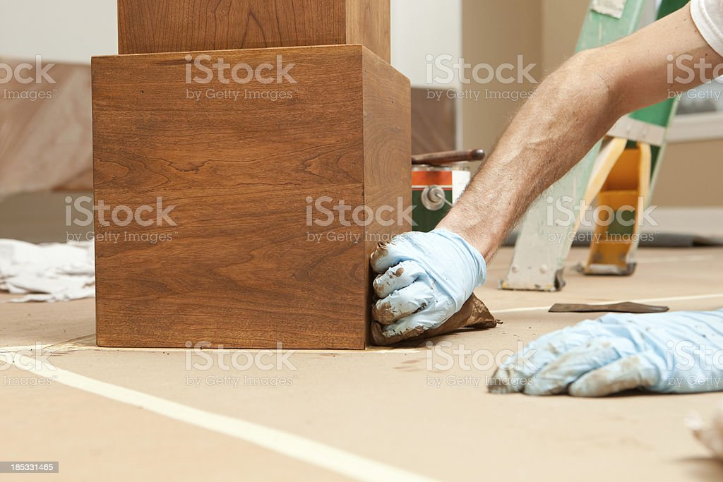 House Painter Staining a Cherry Column royalty-free stock photo