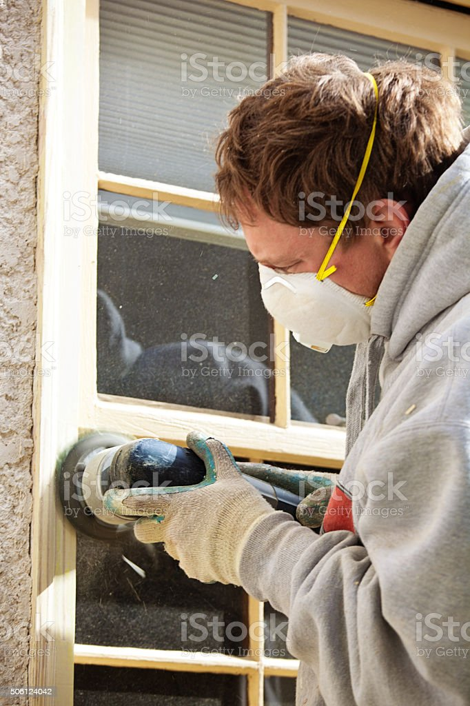 House Painter Using Power Tool Sander, Preparing Window for Painting stock photo