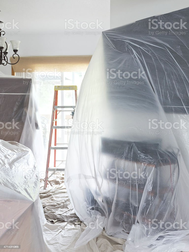 House Painting Interior Project Drop cloth Covered Furniture TV Ladder stock photo