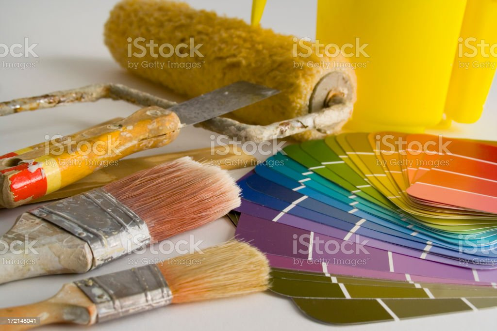 House Painting with Paintbrush and roller for Home Decorating and Improvement royalty-free stock photo
