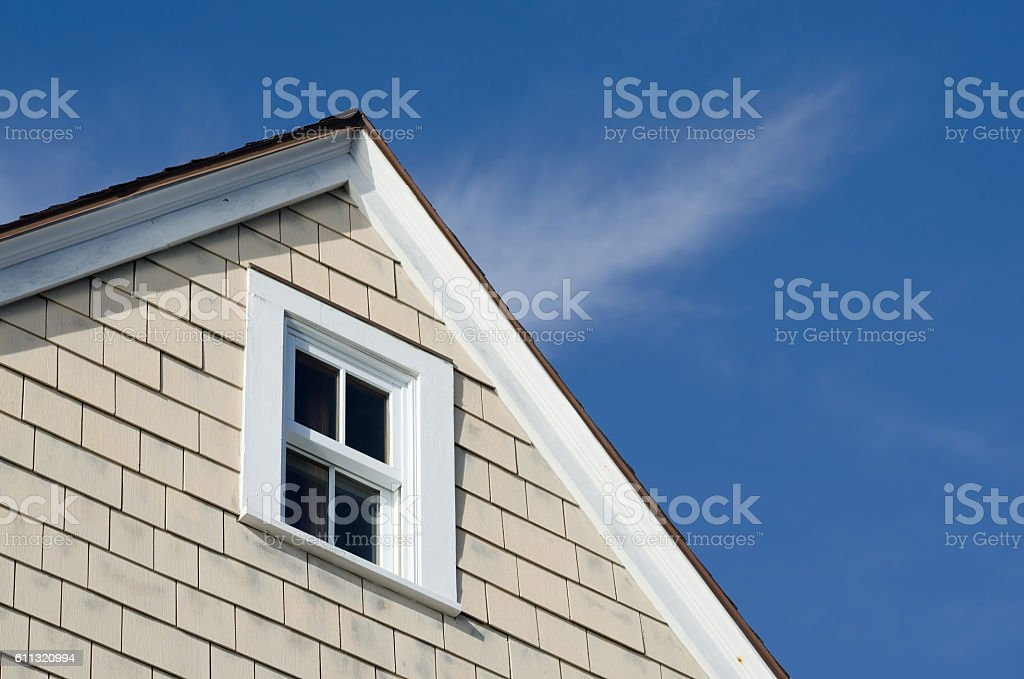House peak with window and blue sky stock photo