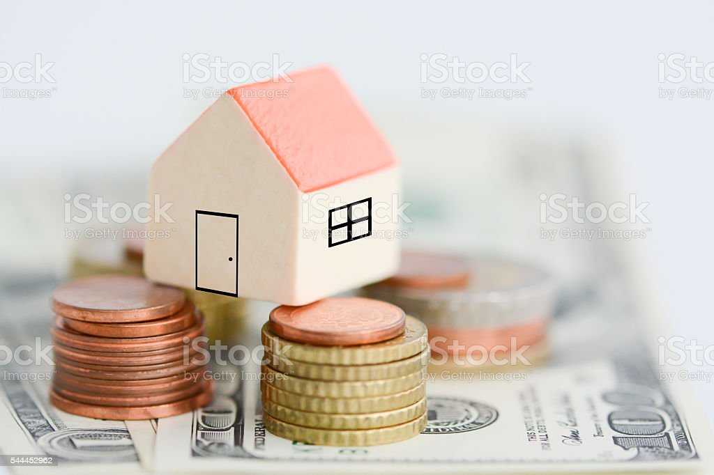 House property prices concept with money pillars from coins stock photo