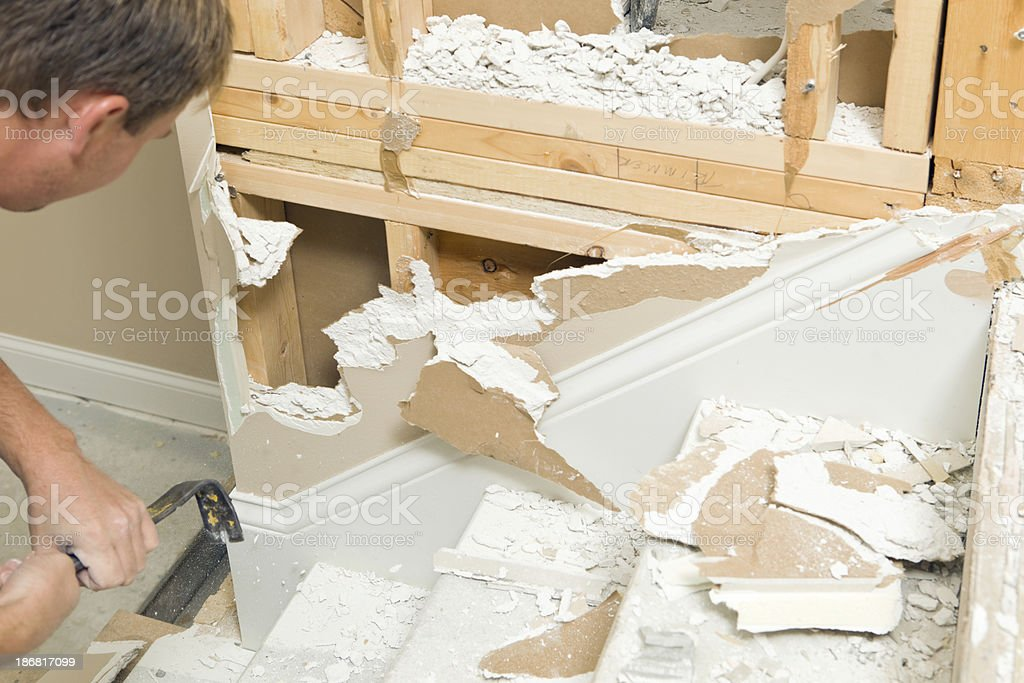 House Remodeling Drywall Demolition near Staircase royalty-free stock photo