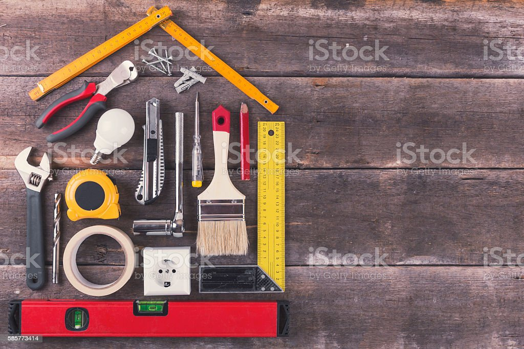 house renovation and improvement DIY tools on wooden background stock photo