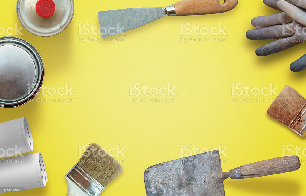 House renovation tools on yellow worker desk. stock photo
