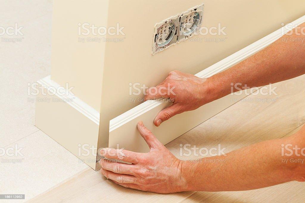 House repairing, skirting board stock photo