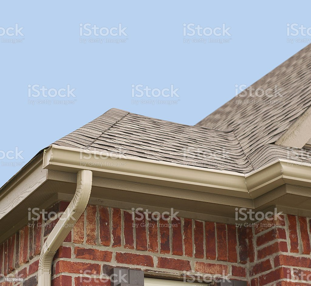 House Roof and Gutters stock photo