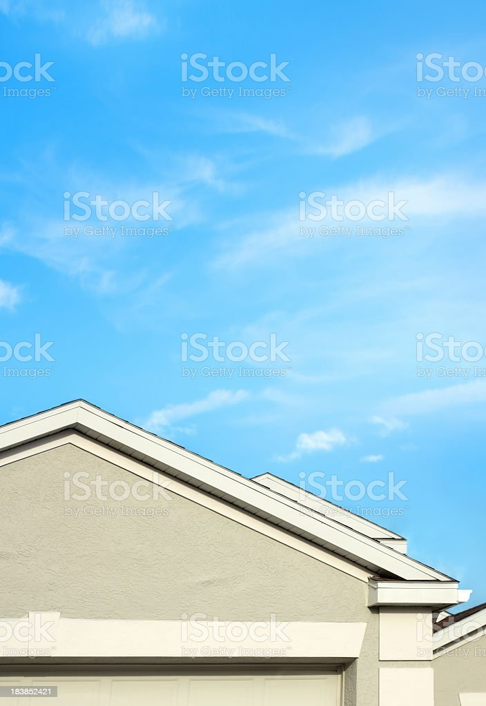 house roof detail over blue sky stock photo