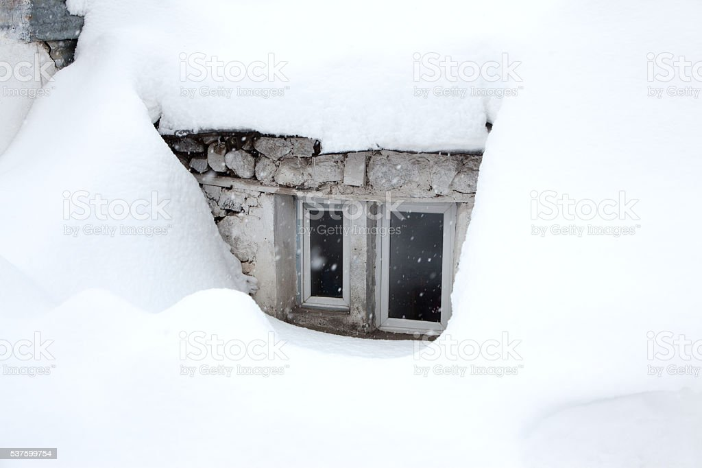 House roof loaded with snow stock photo