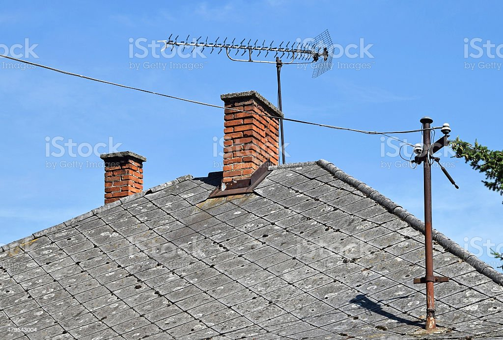 House roof with antenna stock photo