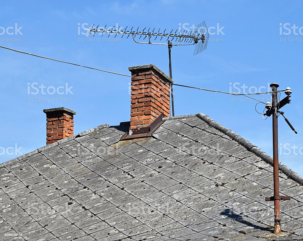 House roof with smoke stacks and antennas stock photo