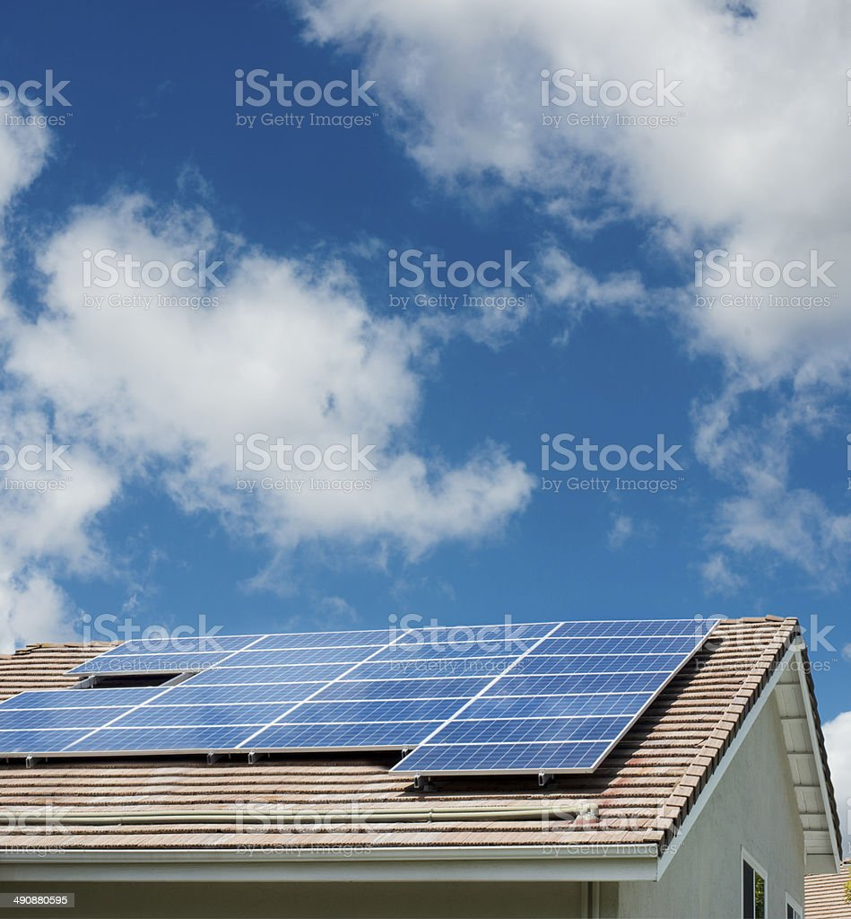 House, roof with solar panels stock photo