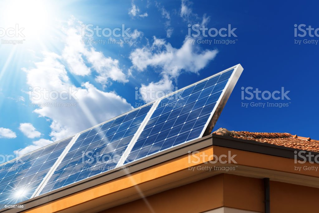 House Roof with Solar Panels stock photo