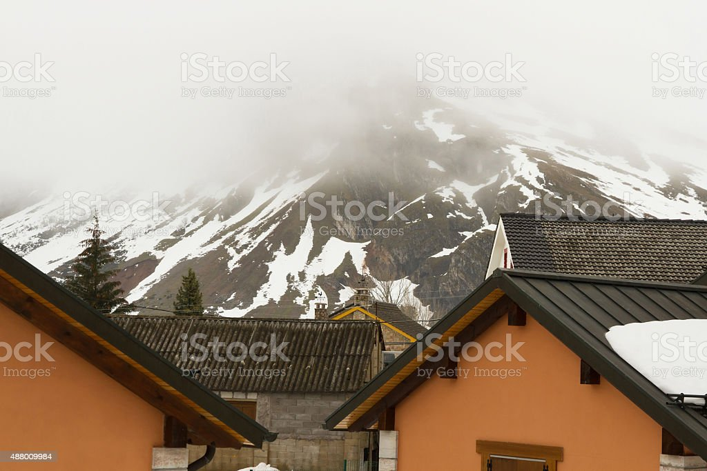 House Roofs Side Snow Mountain - stock photo