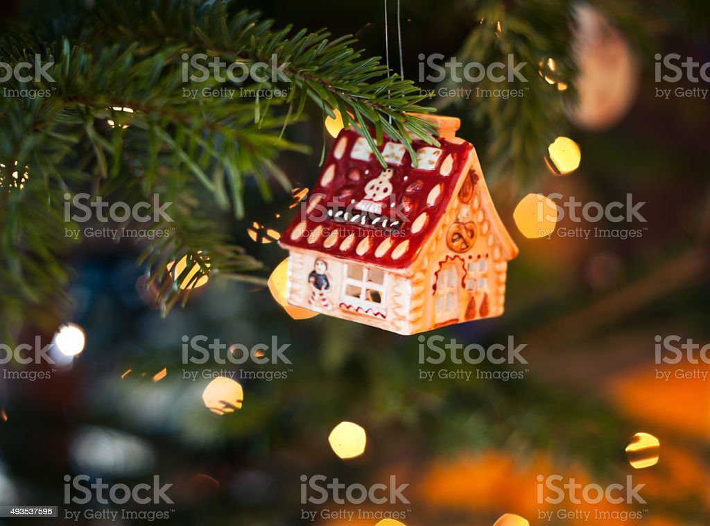 House shape bauble on the christmas tree stock photo