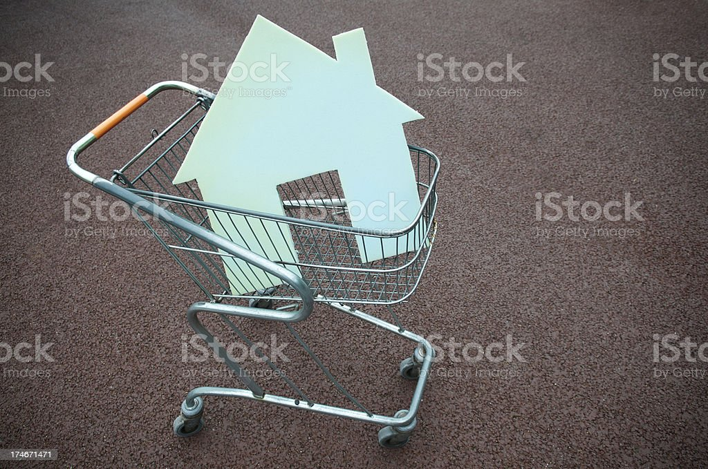House Shape Sits in Shopping Cart stock photo