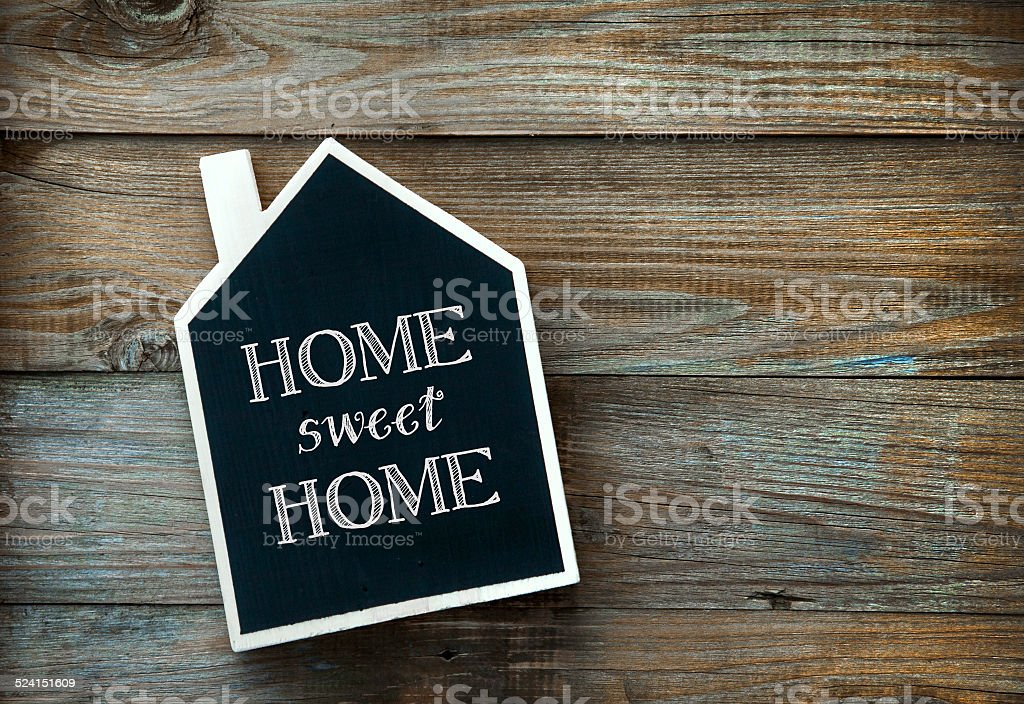 House Shaped Chalkboard sign Home sweet Home on rustic wood stock photo