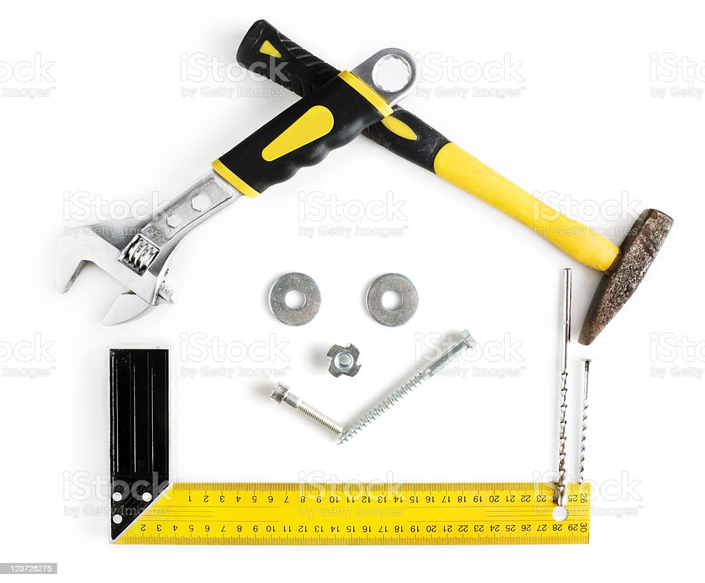 House shaped frame with smile made by tools royalty-free stock photo