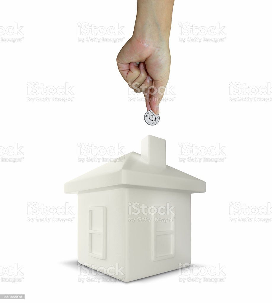 house shaped money box with a coin stock photo