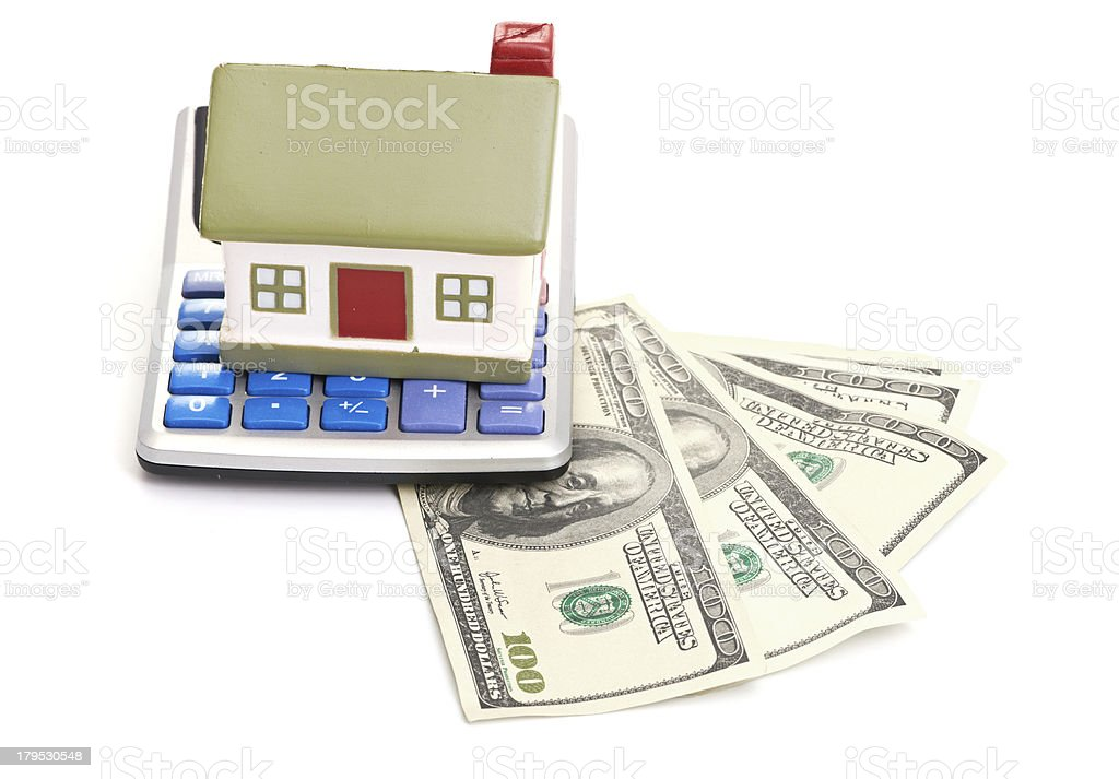 house sitting with a calculator and dollar royalty-free stock photo