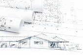 house sketch with blueprints