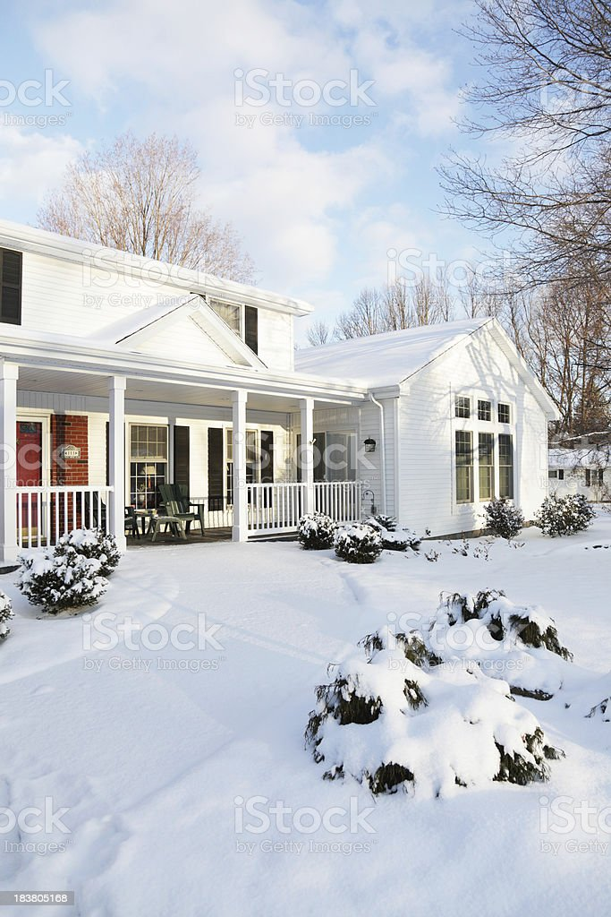 House Snow Home Winter Dawn Morning - Vertical stock photo