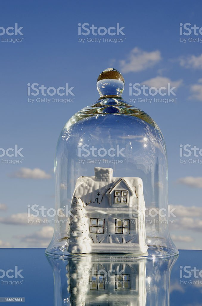 house symbol in the glass jar on mirror stock photo