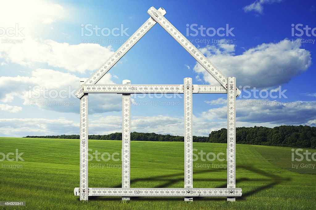 house symbol on meadow royalty-free stock photo