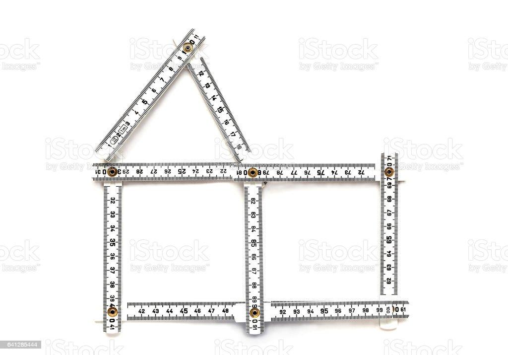 House symbol with folding ruler stock photo