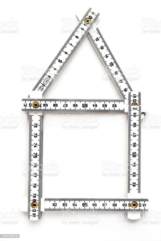 House symbole with folding ruler stock photo