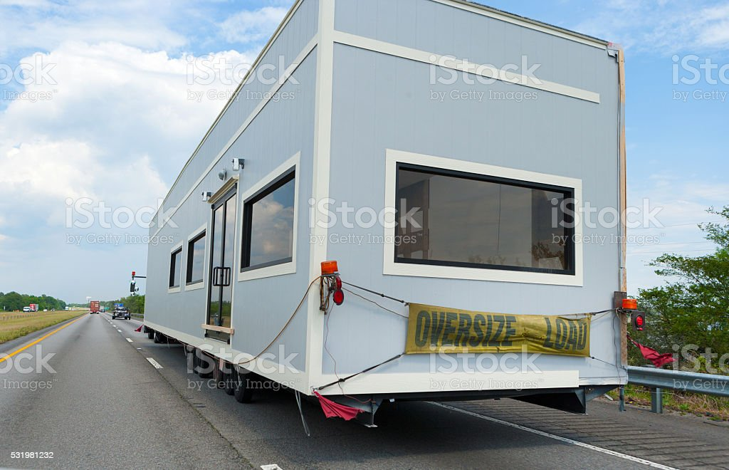 House trailer on a truck on Highway stock photo