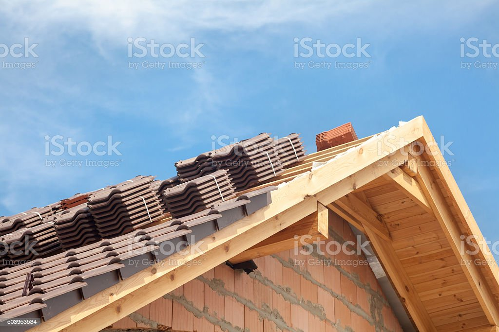 House under construction. Roofing tiles preparing to Install stock photo