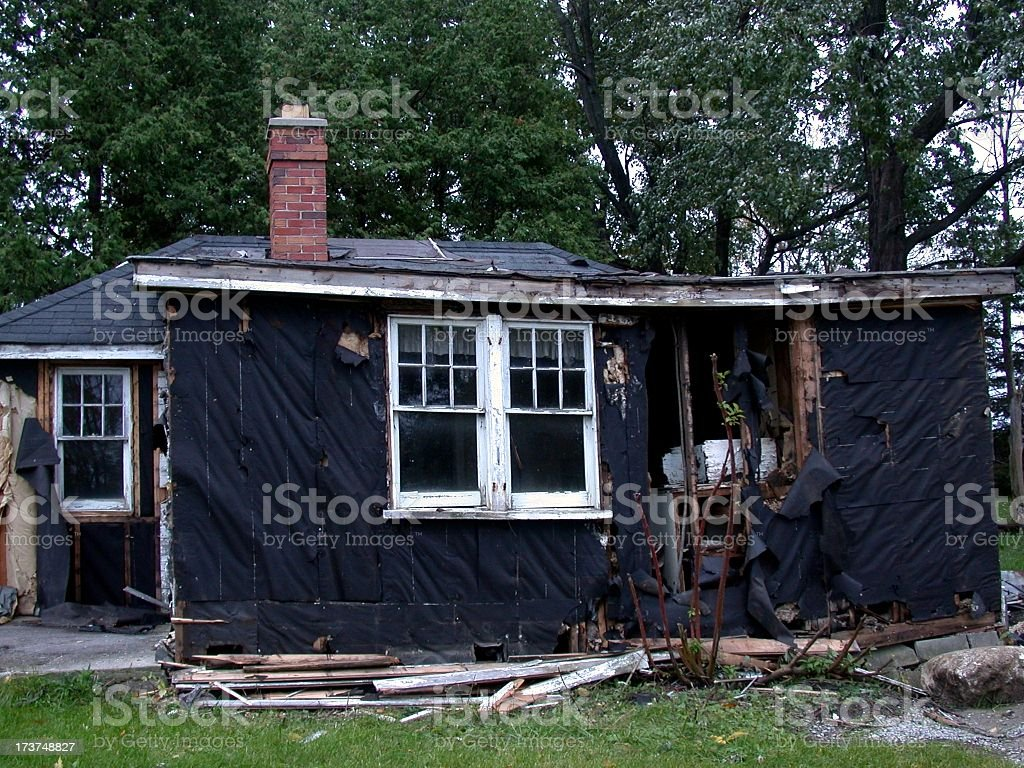 A house under construction with black siding and wood planks stock photo