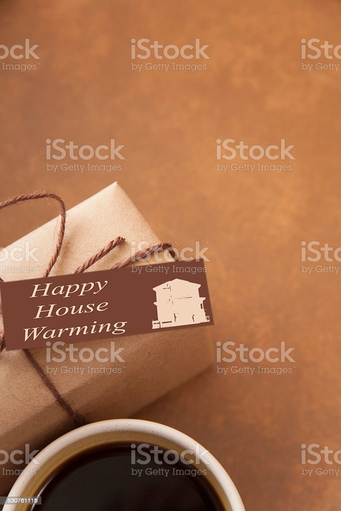 House warming wrapped gift for new neighbors. Coffee. stock photo
