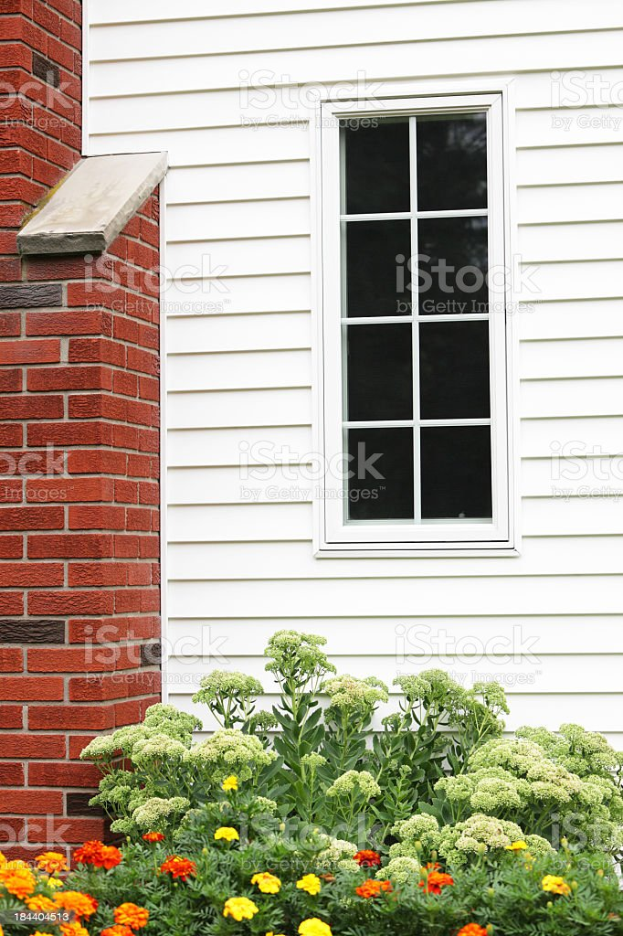 House Window, Chimney and Marigold Flowers stock photo
