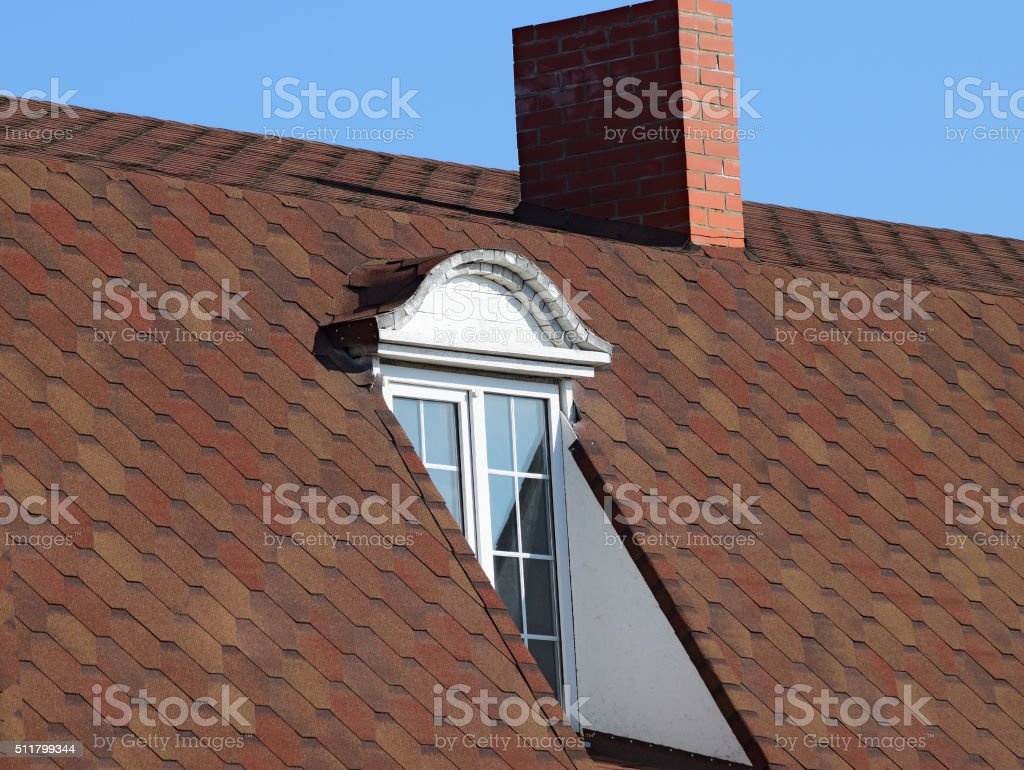 House with a roof made of metal sheets stock photo