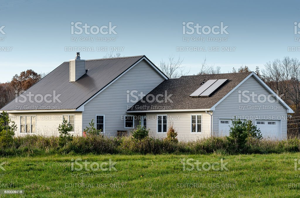 House with a Roof -Mounted Solar Water Heater stock photo