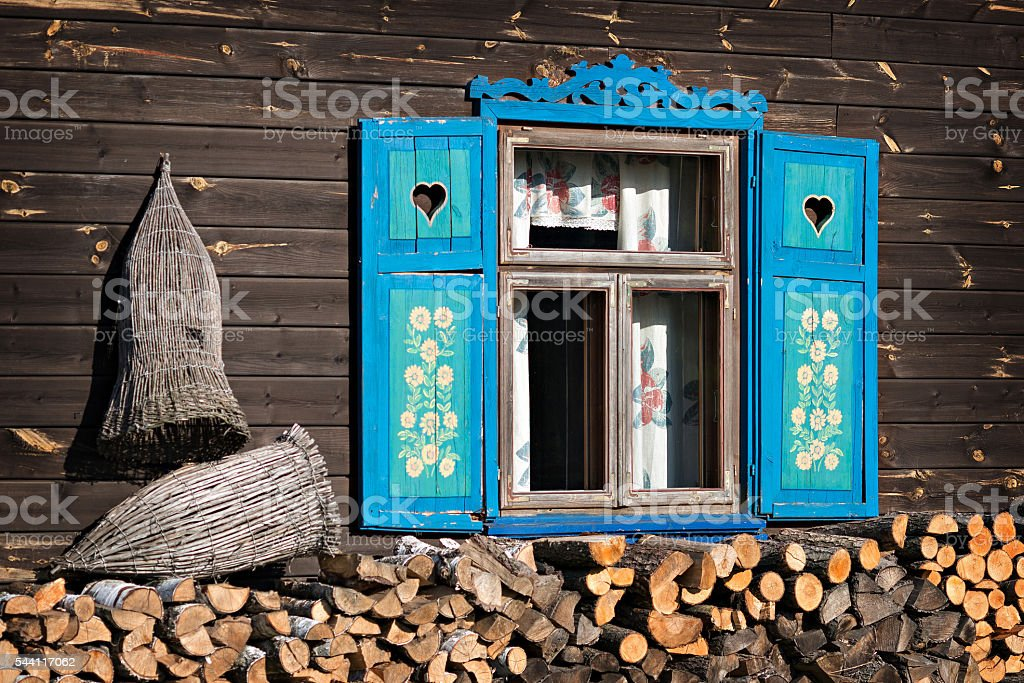 house with blue shutters stock photo