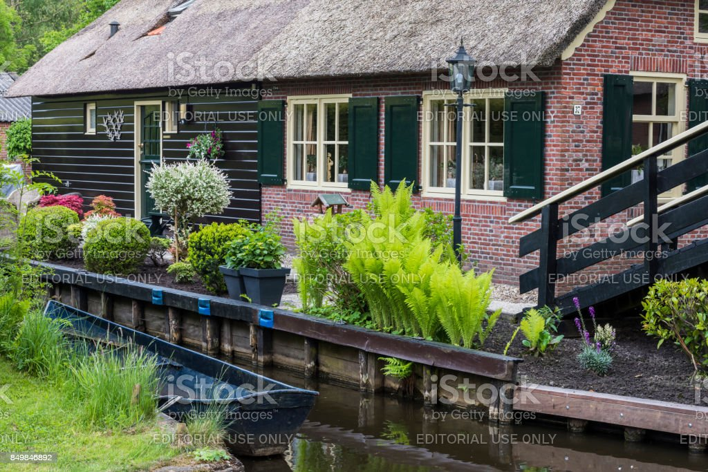House with Boat Giethoorn stock photo