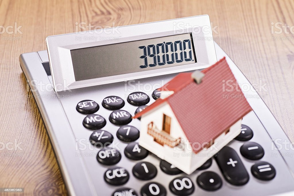 House with calculator stock photo