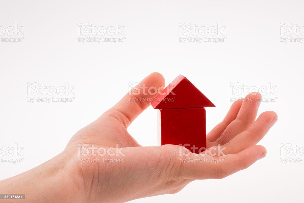 house with cubes in hand stock photo