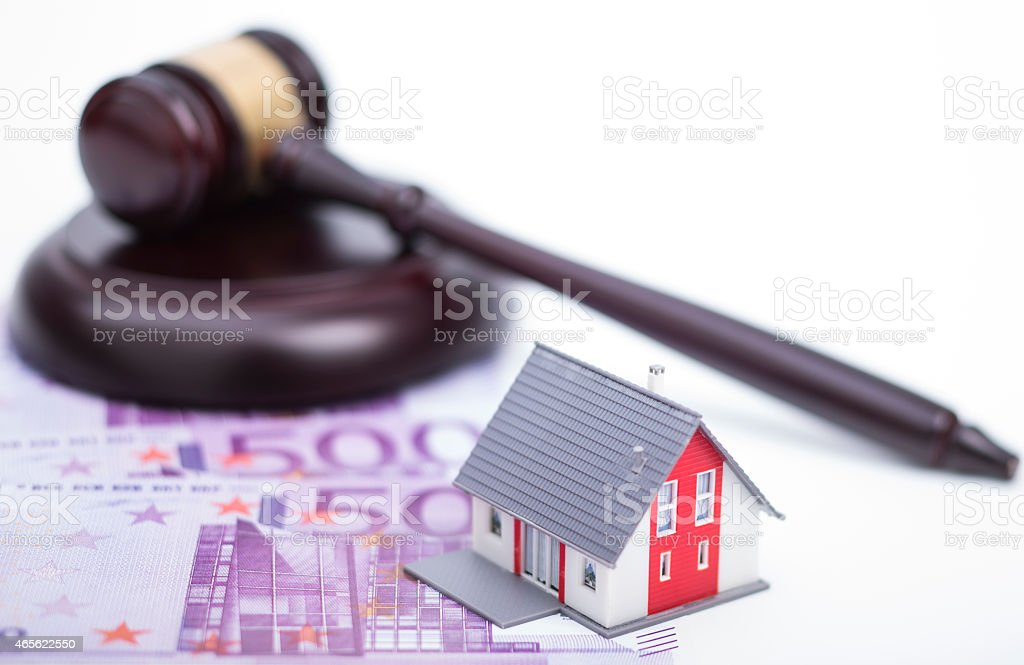 House with money and judge gavel stock photo